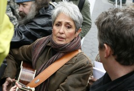 NEW YORK, NY - NOVEMBER 11: Joan Baez and Dirk Powell perform at Foley Square on November 11, 2011 in New York City. (Photo by John Lamparski/WireImage)
